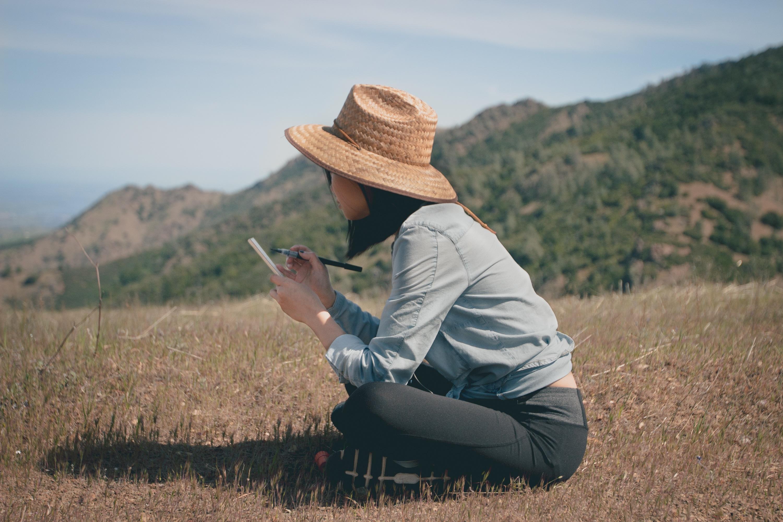 woman_writing_in_journal_outside.jpg